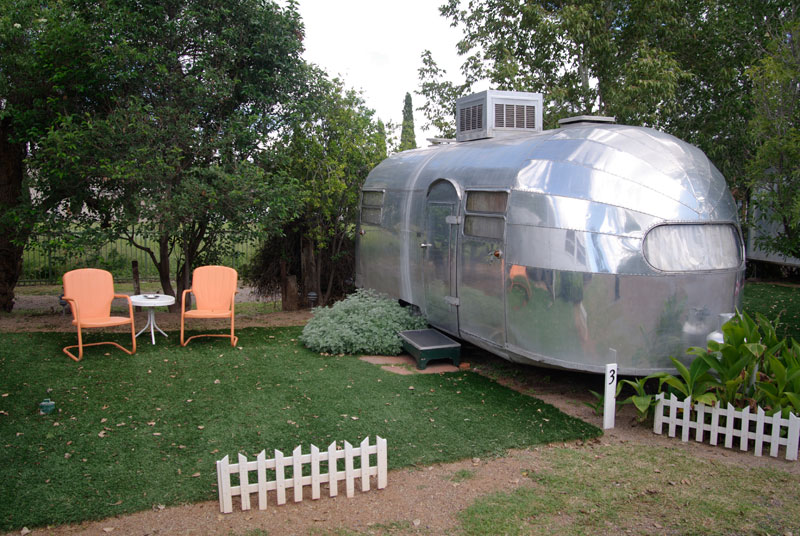 A 1955 Airstream is one of the vintage mobile homes visitors can stay overnight in at the Shady Dell Trailer Park in Bisbee, Arizona