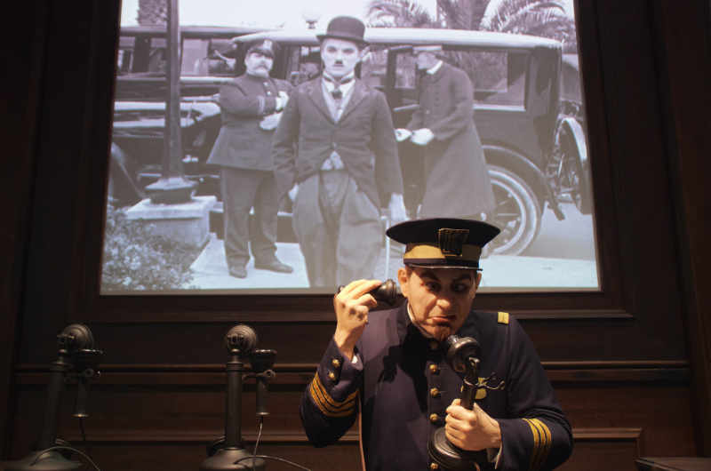 Footage of a Charlie Chaplin film plays before waxwork figure at Chaplin's World museum
